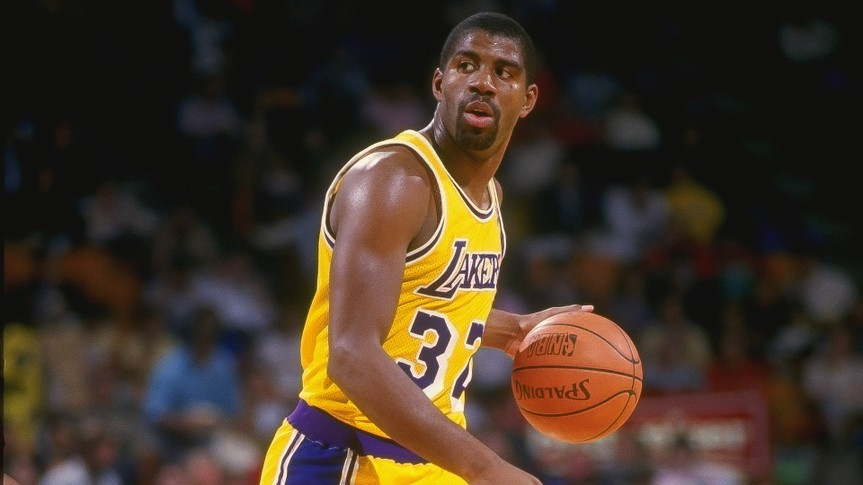 1987:  Guard Magic Johnson of the Los Angeles Lakers dribbles the ball during a game at the Great Western Forum in Inglewood, California.