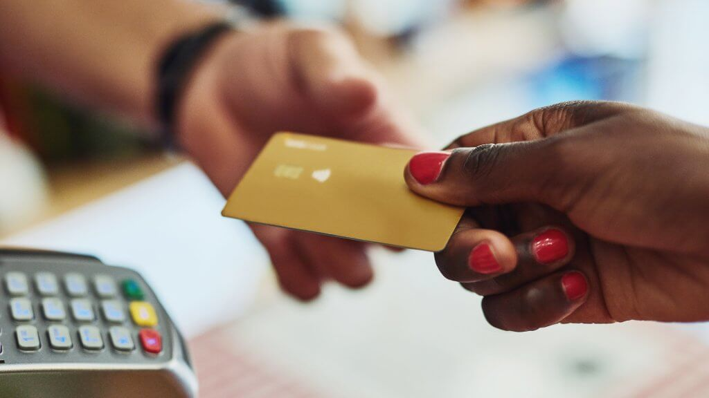 3 best business credit cards for bad credit gobankingrates cropped shot of an unrecognizable customer making payment in a store peopleimages istock a business credit card reheart Image collections