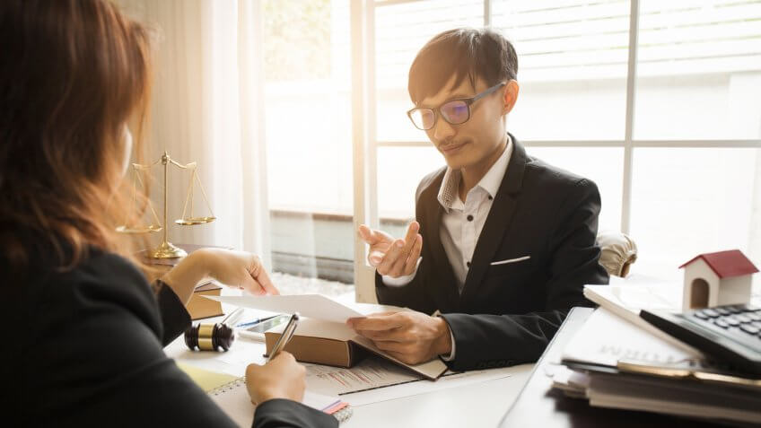 Consultation between attorney and employer about the tax laws for buying houses and residences in private areas to pay taxes economically to the government in accordance with the national law.