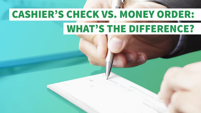 person filling out a check