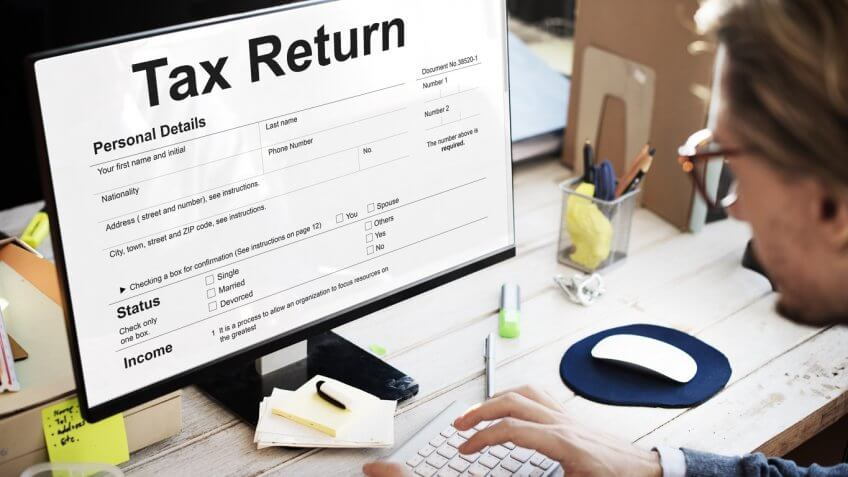 man filing a tax return online