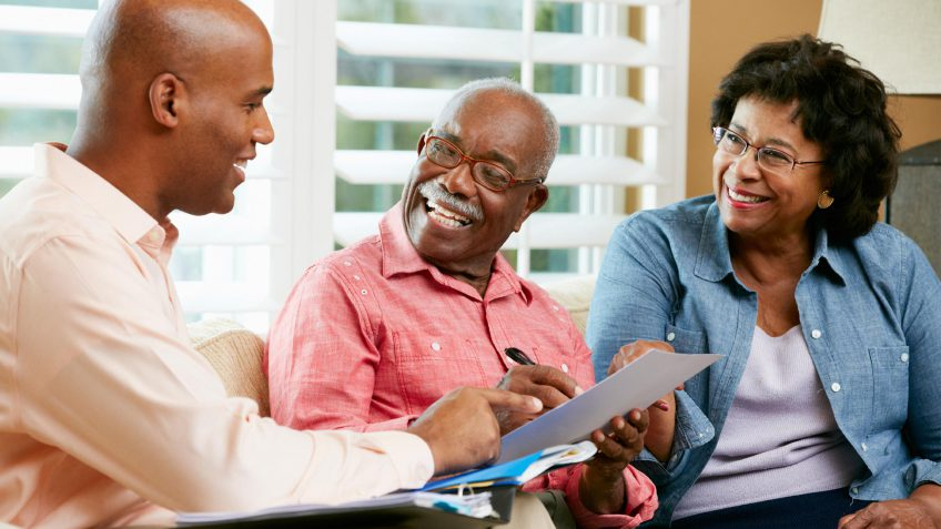 Retirees talking to finance professional