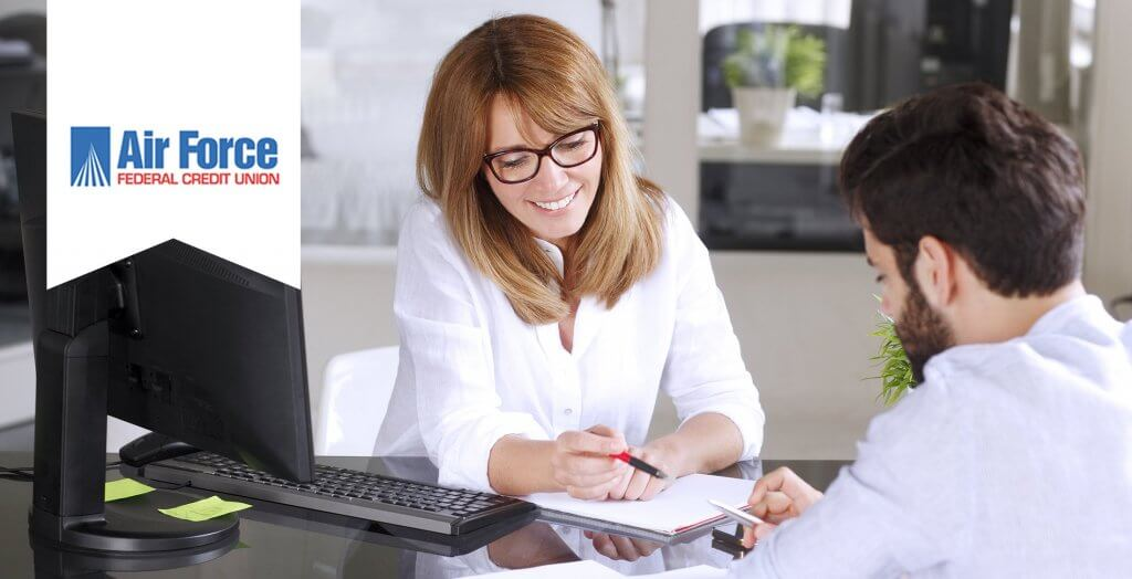 woman reviewing paperwork for man