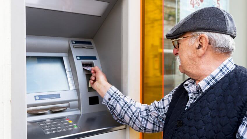 senior man at ATM