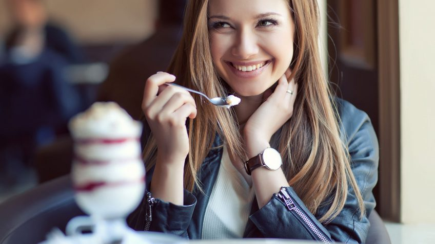 young woman eating a parfait
