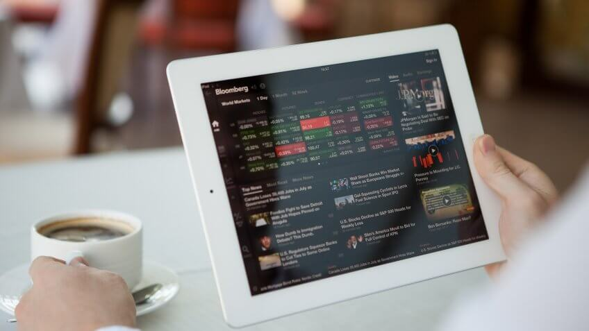 Man using Bloomberg app on iPad at lunch time