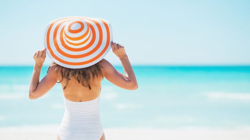 woman with a sun hat on the beach