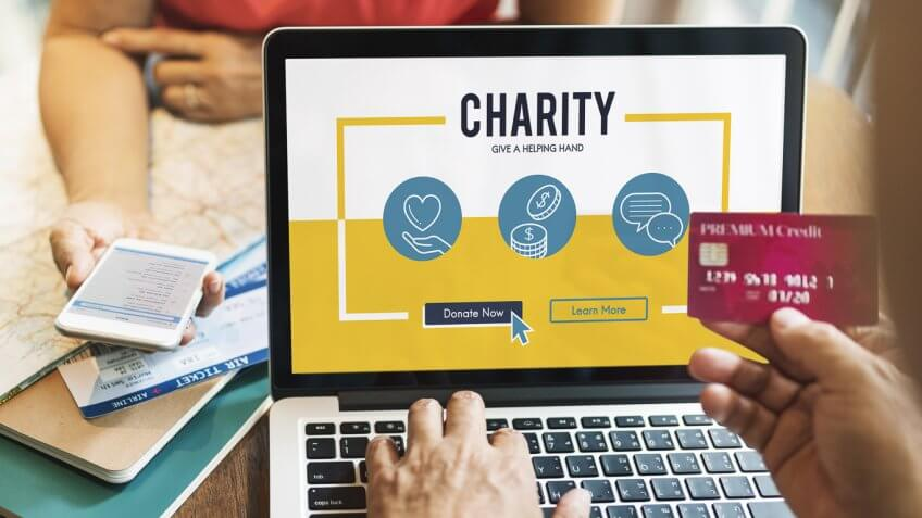 person donating to a charity online