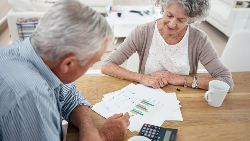 senior couple reviewing their financial investments