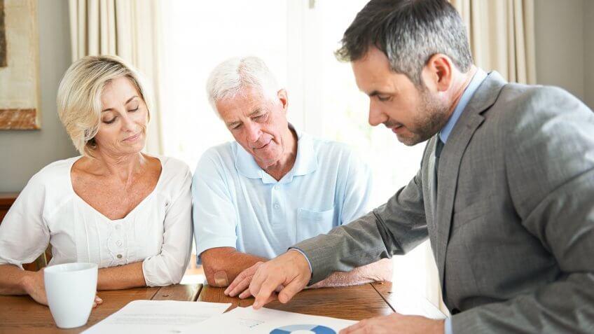 financial advisor visiting a senior couple in their home