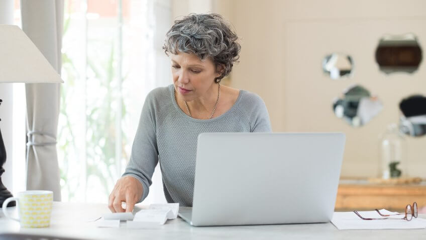 Senior woman working on home finance.