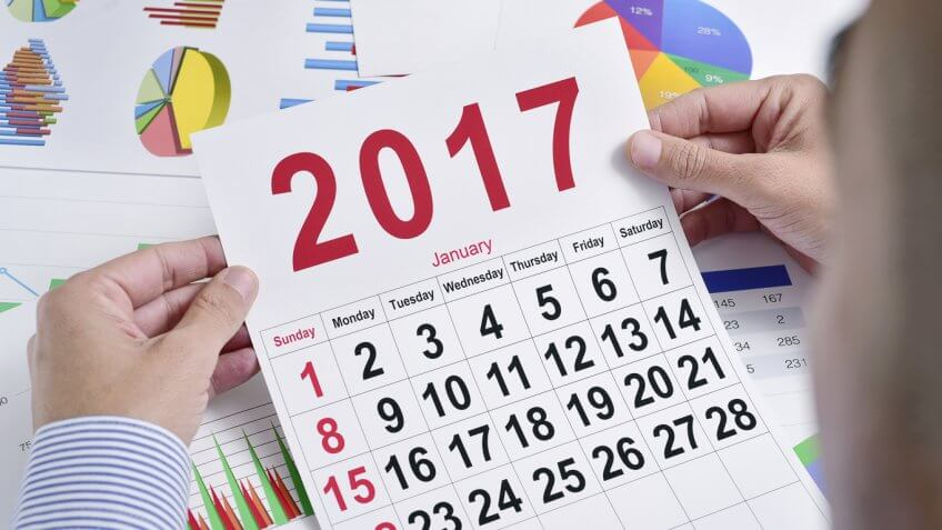 person looking at a 2017 calendar