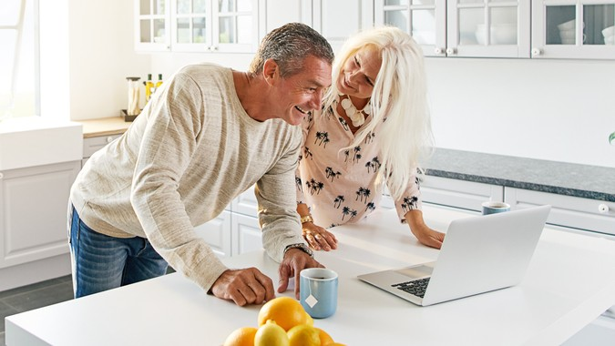 An older couple discusses how best to maximize 401(k) contribution limits.