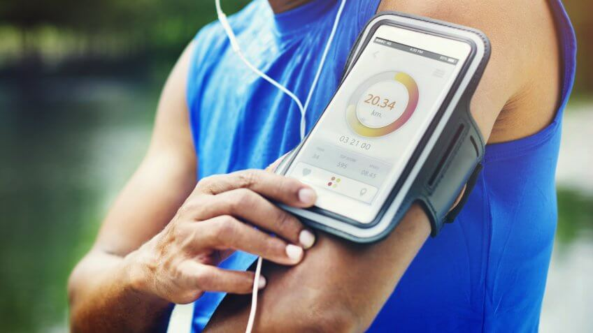 man-running-tracker-armband-fitness-app-tracker