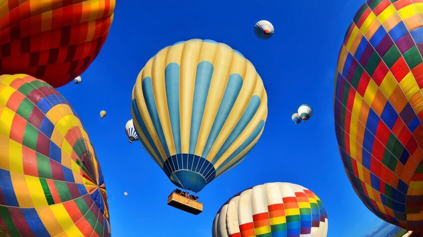 Air Vehicle, Colorful hot air balloons against blue sky - Stock imageHot Air, Mode of Transport, Summer, sunset