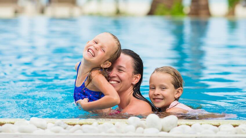 mom and two daughters in the swimming pool