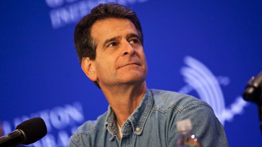 NEW YORK - SEPTEMBER 24: Dean Kamen, founder of Deka R&D listens during a news conference at the Clinton Global Initiative (CGI) meeting on September 24, 2013 in New York City.