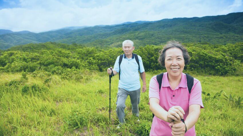 active elderly couple on a hike