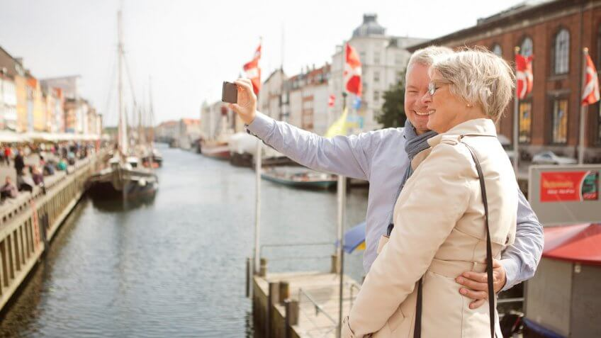 elderly couple on an outing by the docks