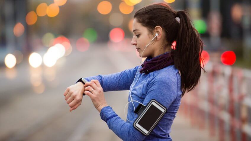 young-woman-blue-sweatshirt-running-with-fitness-apps-smartphone