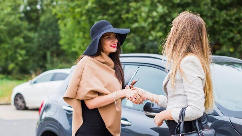 two women shaking hands