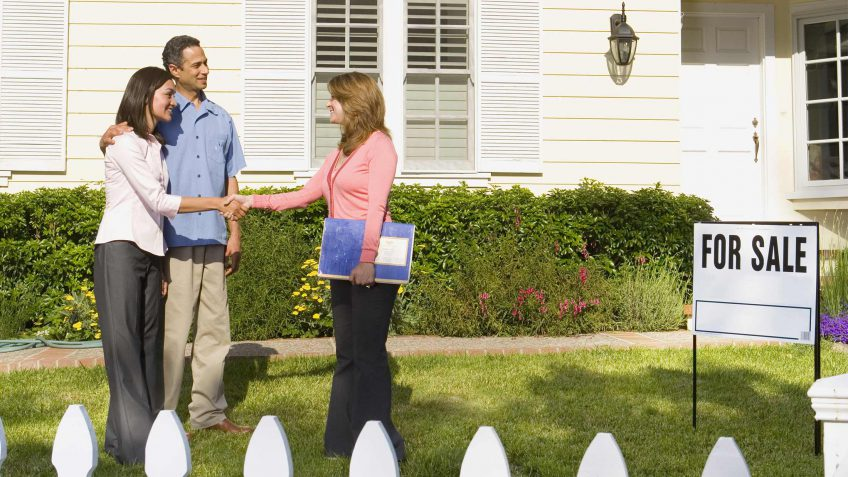 couple meeting with a real estate agent