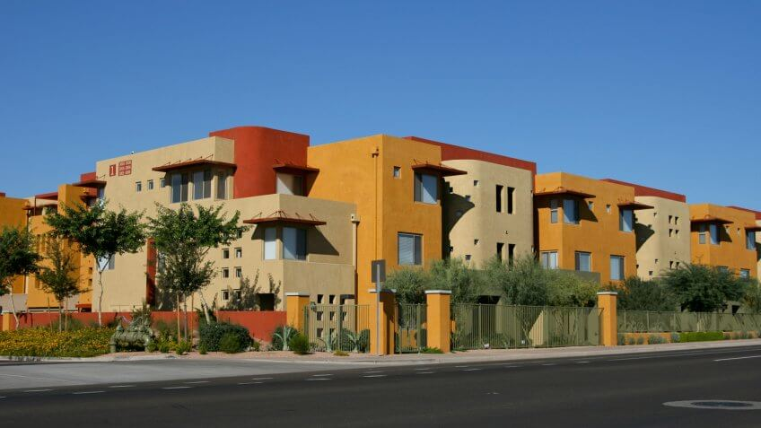 Street views of vibrantly colored luxury apartments in north Scottsdale, AZ with street for copy space (how convenient!).