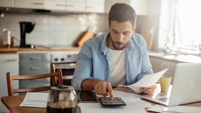 Photo of a man going through his financials problems.
