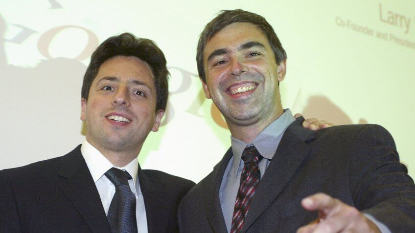 FRANKFURT, GERMANY - OCTOBER 7:  Google founders Sergey Brin (L) and Larry Page (R) joke prior to a news conference during the opening of the Frankfurt bookfair on October 7, 2004 in Frankfurt, Germany.