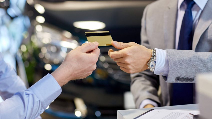man paying with a gold credit card