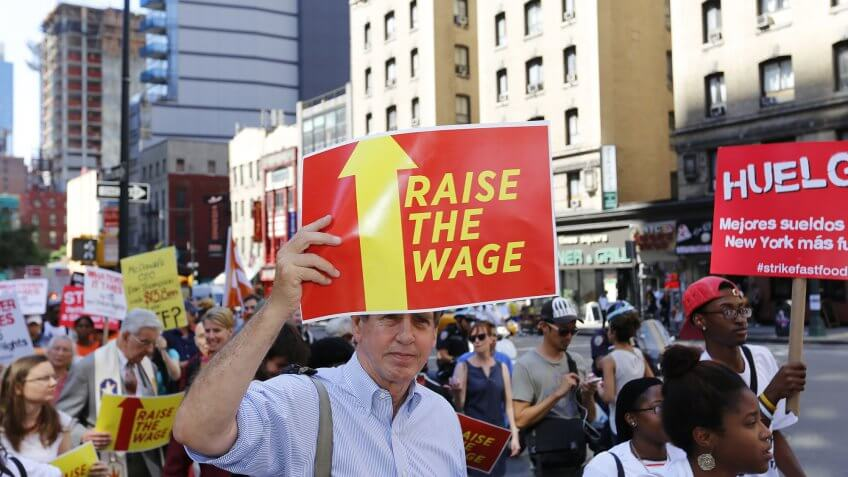 people protesting for higher wages