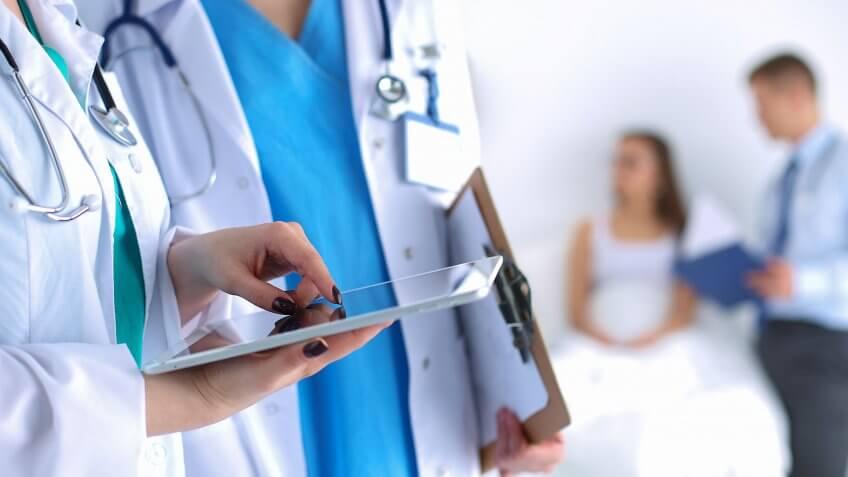 doctors looking at ipad