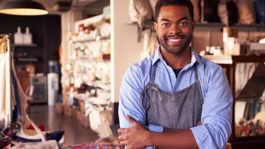 artist in apron in store