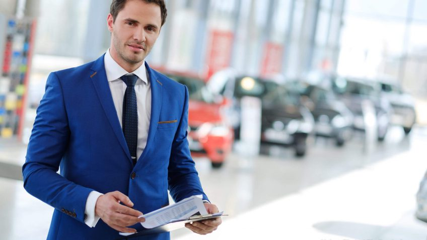 salesman in a blue suit carrying and invoice