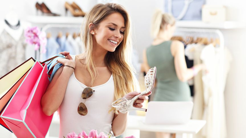 Picture showing happy woman shopping for shoes.