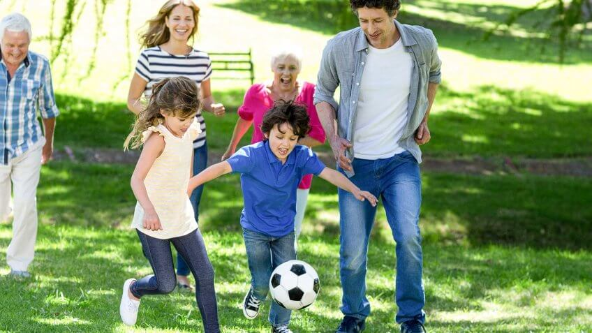 2017, August Is Family Fun Month- Here Are 20 Free Ways to Celebrate, Smiling family playing football in the garden
