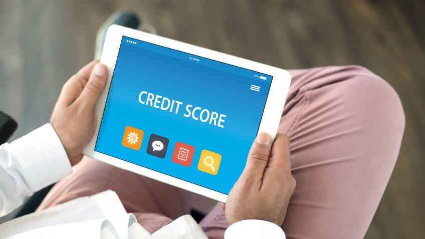 11807, 28 Things That Can Mess Up Your Credit Score, Horizontal, credit score, mobile, person, tablet
