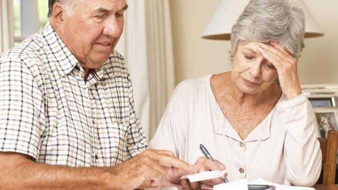 Senior Couple Concerned About Debt Going Through Bills Together.