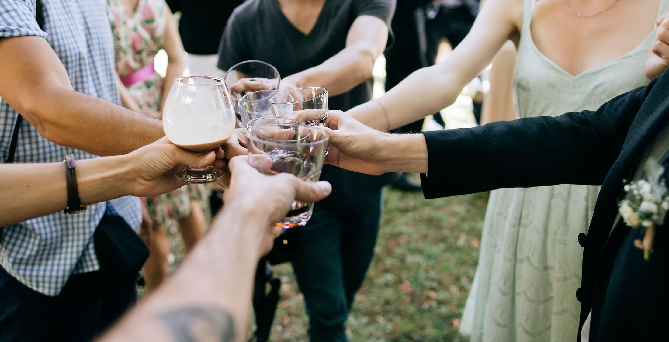 people performing a toast with champagne