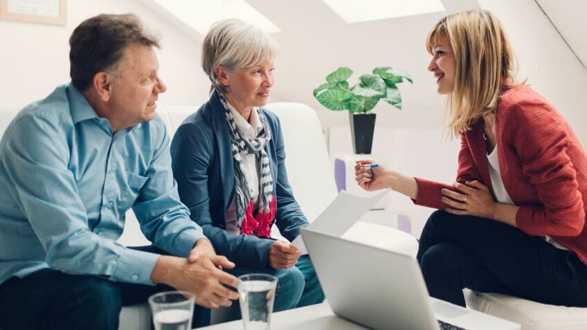 Mature Couple Meeting with Financial Advisor.
