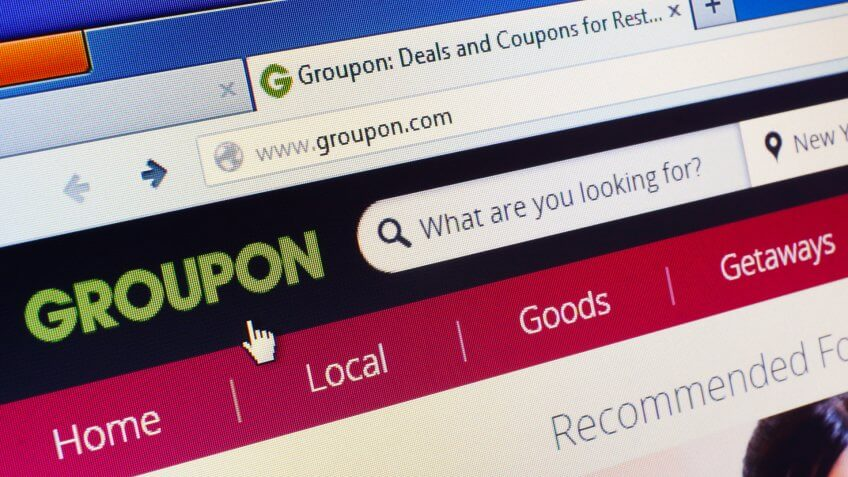 close up of groupon website open on a computer screen