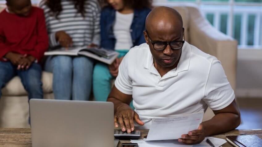 11902, Horizontal, african american man reviewing utility bill