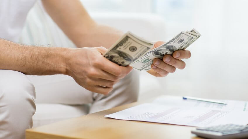 11902, Horizontal, man counting USD money