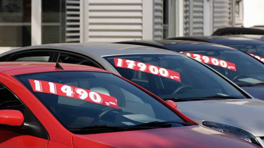 Row of used car with prices.