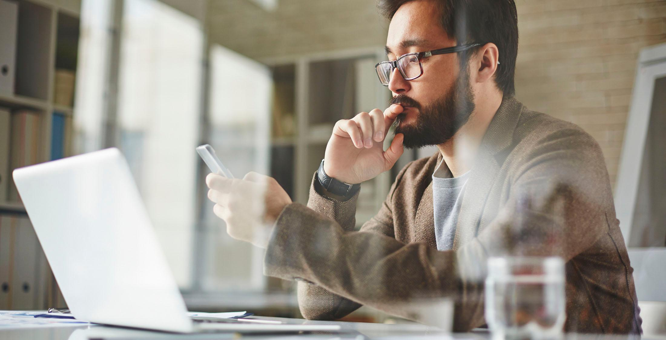 Modern office worker writing sms text message