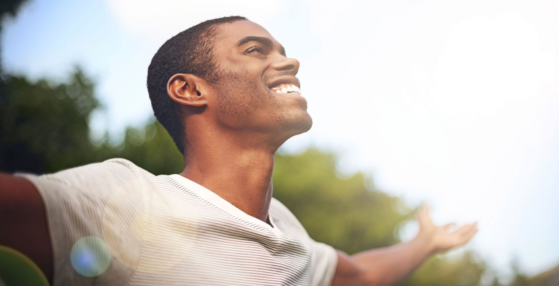 man smiling and spreading arms