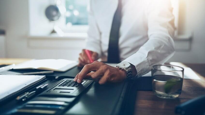 banker using calculator