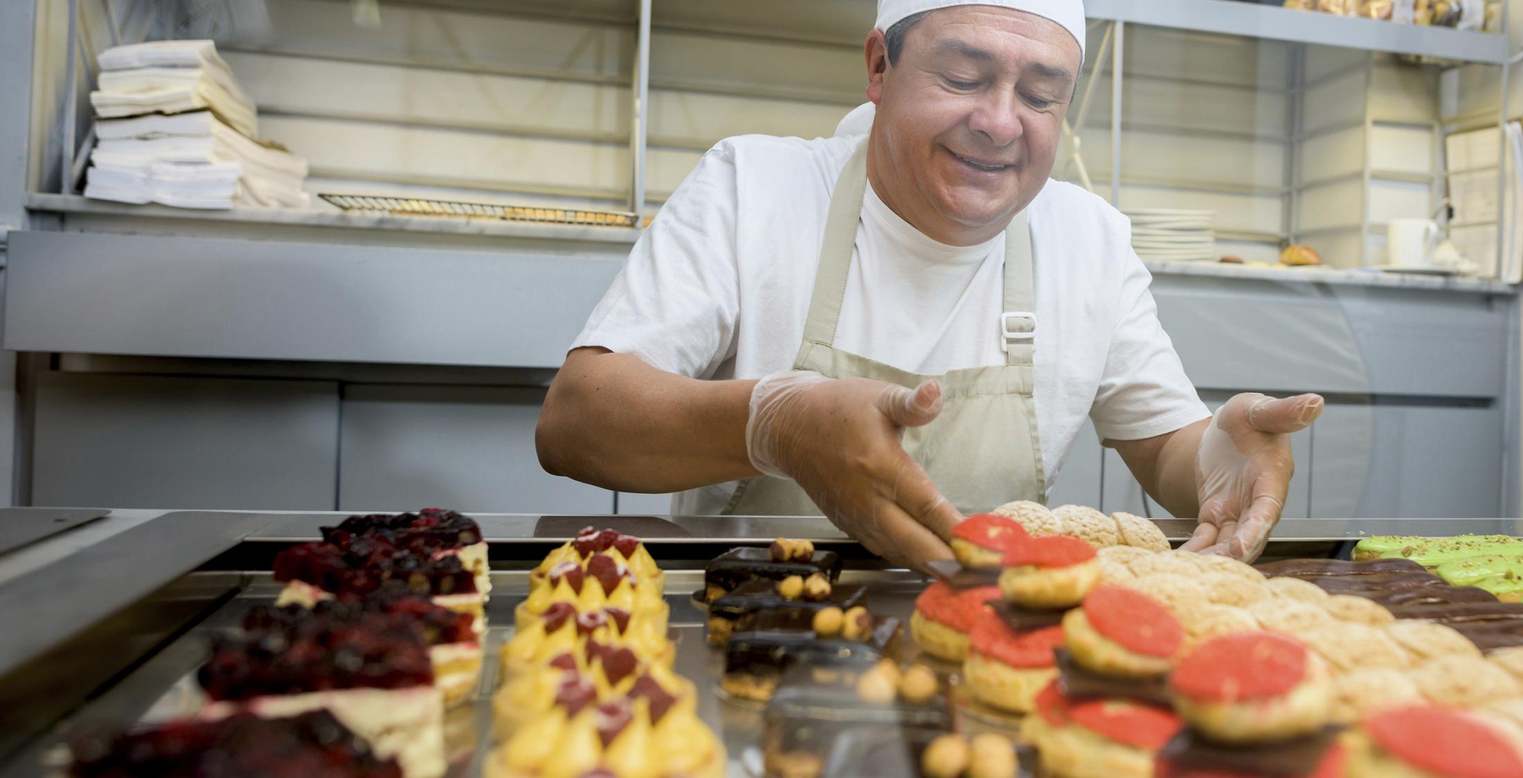 Happy man baking sweet treats