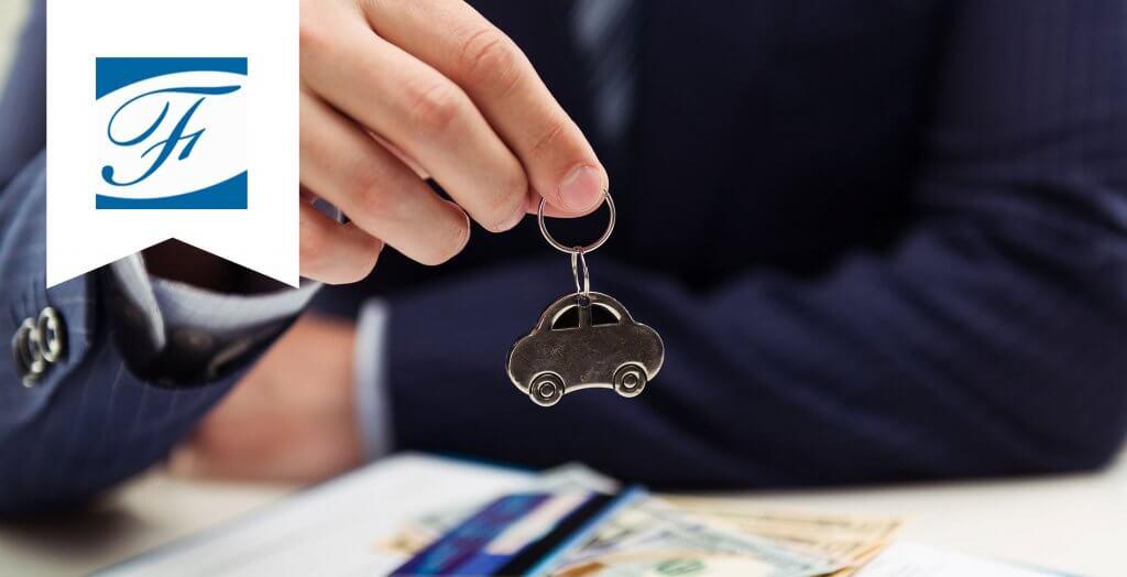hand holding tiny car keychain