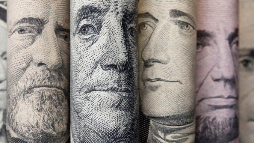 Portraits of U.S. presidents on dollar bills.